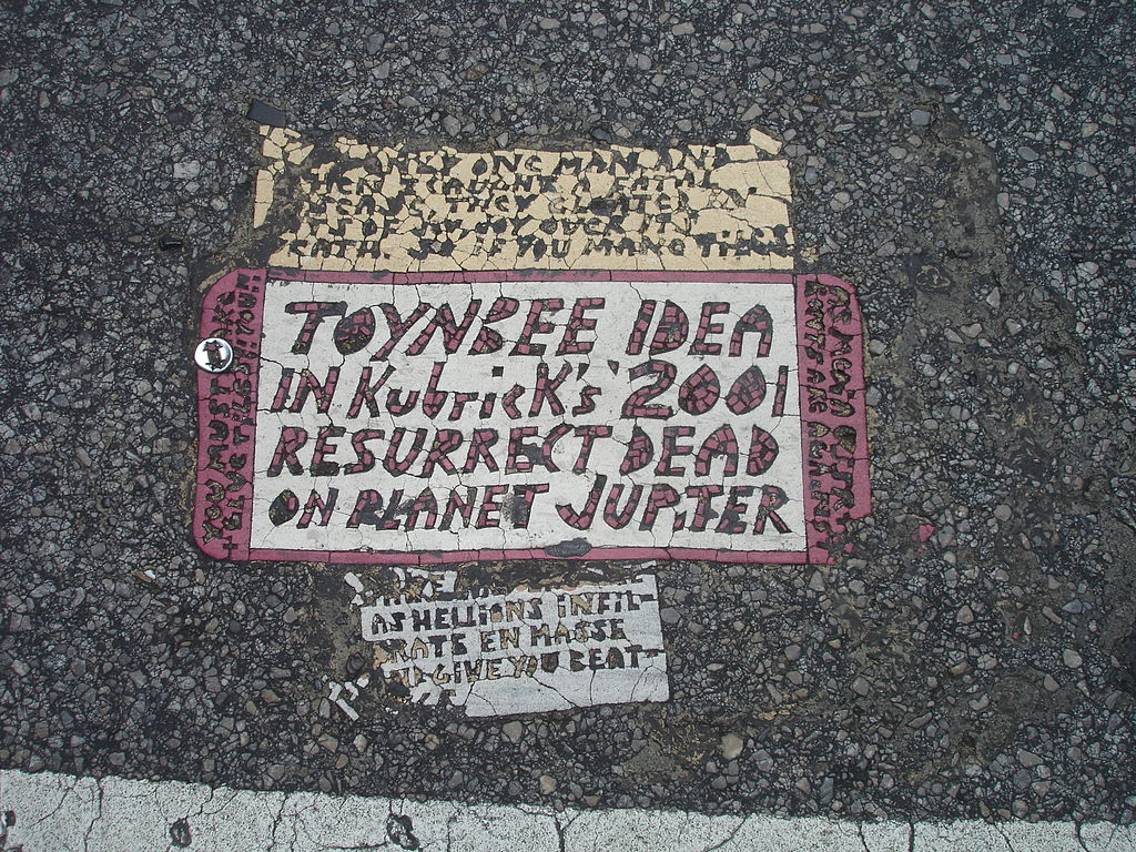 1024px-Toynbee_tile_in_crosswalk_at_intersection_of_13th_and_Market_streets_Philadelphia